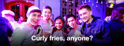 Image of five people smiling in FiveSixEight bar, with text: Curly fries, anyone?
